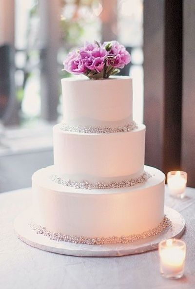 Buttercream-frosted wedding cake. Click through to see the r ...