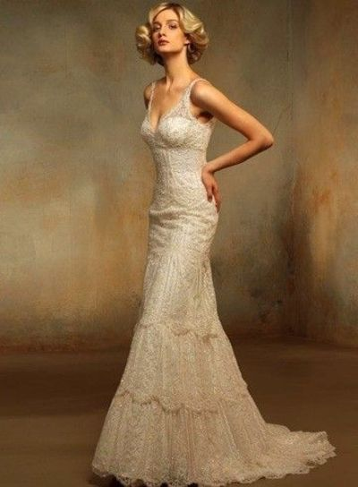 Vintage cream colored fitted ivory lacy wedding gown for Cream colored lace wedding dresses