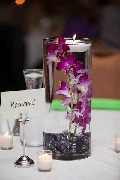 Floating candle and orchids wedding reception