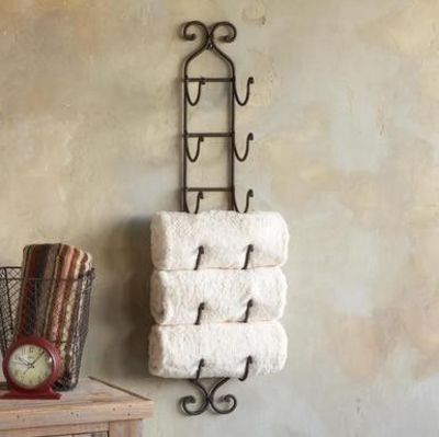Wine rack = creative way to hold bathroom towels