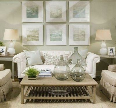 Soft green beachy coastal living room design with white for Green and beige living room ideas