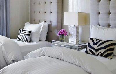 twin beds zebra pillows upholstered headboards