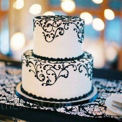 Two tier black and white wedding cake.