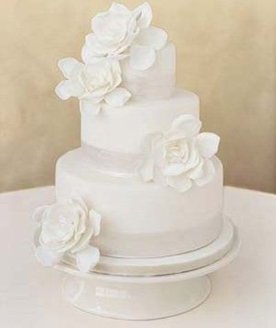 All White Wedding Cake With Magnolia Flowers