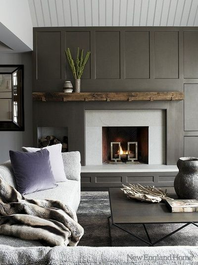 Slate grey wainscot, reclaimed wood mantle, offset log storage