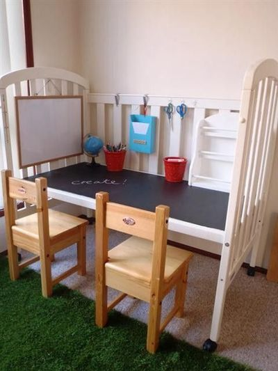 Upcycle an old crib into a kids work station