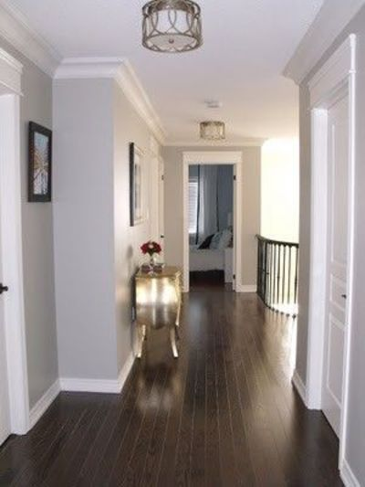 Grey walls, white trim, dark wood / For the home - Juxtapost