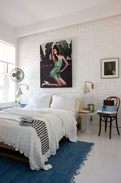 I like the texture of the bedding and the walls but I don't care for the art work hanging.