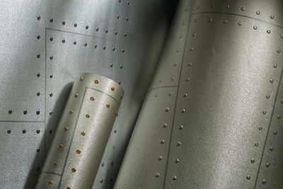 Phillip Jeffries Aviator Wallpaper Looks Like Metal Wall Covering