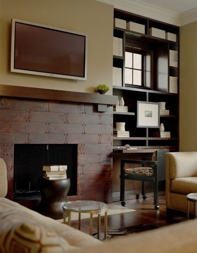 Innovative  Integrated Bookcases Either Side Of Open Fireplace And Classic Chairs