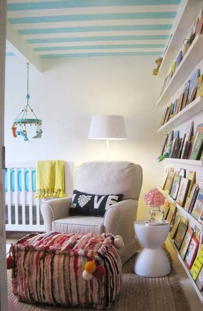 Love the ceiling and the wall of books for basement living room!!!!!