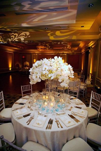 White Wedding Floral Table Decor With Blue And Gold Accents Wedding Ideas