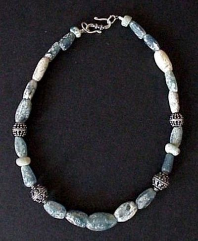 Ancient Roman Glass Beads Found along the trade route passing from Europe through northern Africa, these ancient Roman glass beads are a treasure! The beads vary in size and shape and all show the beautiful pitting from being buried in the sand for centur...