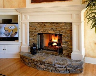 Like this for the basement family room. fireplace with corne ...