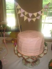 Layer cake with pale pink buttercream...