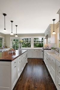 Largi island, lots of cabinets, still feels ope, wouldn't have picked white cabinets but I like