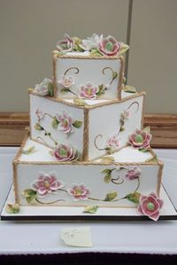 square wedding cake with gumpaste flowers