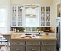 Island, glass front cabinets.