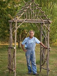 Make your own rustic arbor using twigs and logs. This guide takes you through all the steps.