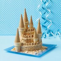 Sandcastle Cake by familyfun: Easy fun with vanilla wafers, jumbo and small ice cream cups, sugar cones and graham crackers. http://tinyurl.com/3bv9wow #Cake #Sand Castle Cake #Castle Cake #familyfun