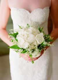 lily of the valley and ranunculus bouquet