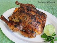 Slow Roasted Chicken with Cilantro-Citrus Butter --I slow roasted the bird and my house smelled fantastic all afternoon - I love that. I served this chicken with Roasted Tomatoes with Cotija Cheese and Cilantro and Lime Rice for a tasty and healthy dinner...