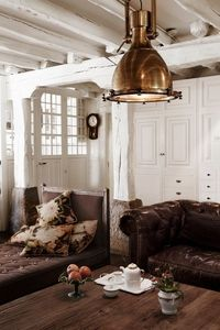 copper flood light, leather chesterfield, french day bed, brown and white perfection.