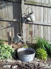 Thought I'd pass along this water fountain tutorial using galvanized watering cans, a galvanized tub and small water pump...Check out the full tutorial.