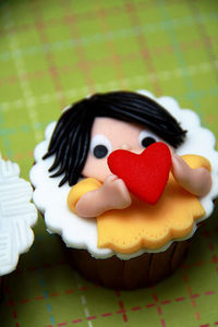 Girl holding a heart Valentine's Day Cupcakes