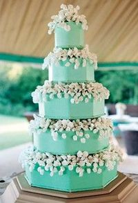 white flowers on an aqua-tinted cake