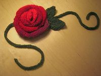 Cute knit puffy blooming rose bud. Wear it as a belt, bracelet, necklace, or headband or tie it around your ugly garbage can. Add a drop of essential oil to the center.