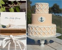 Yellow Nautical Wedding Cake with White and Navy Accents.