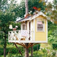 treehouse with a white picket fence.