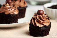 dark chocolate cupcakes with marshmallow filling and malted chocolate buttercream.