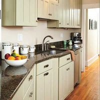 Green kitchen cabinets.