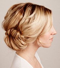 1. The classic side pony by A Cup of Jo. 2. A fishtail braid bun by My Yellow Sandbox. 3. The double hair knot pony by Fashionising. 4. Carrie Bradshaw's big messy bun made easy. 5. Quick and easy three twisted buns updo.