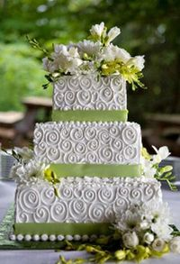 Classic wedding cake with a bride and groom toppers