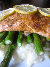 Broiled Salmon: Broiled salmon served over a bed of asparagus and lemon risotto!