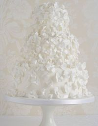 Beautiful white frilly petals wedding cake by Peggy Porschen