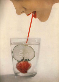 July Harper's Bazaar 1953 The champagne fruit glass by Steuben in a life-sized, shining crystal of gigantic measure. Lucien Lelong's 'Okatea Red' lipstick.