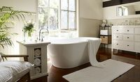 Looks like an IKEA chest of drawers for the basins? Very pretty bathroom.