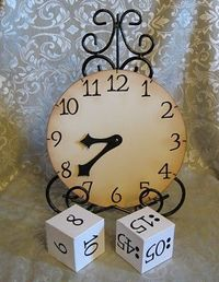 Telling time: roll dice, match time on dice to clock, state time aloud